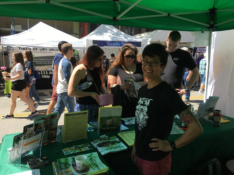 Eva Piccininni tabling for the animals at the U District Streetfair this weekend.