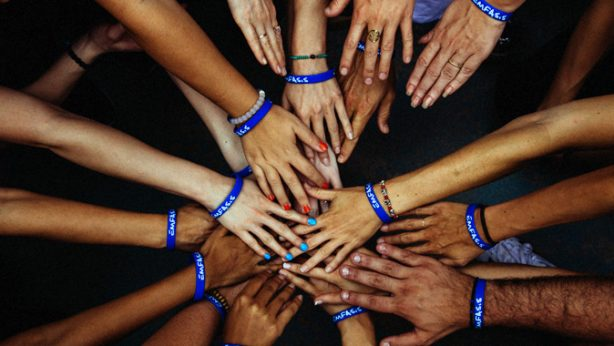 Group of people with hands together